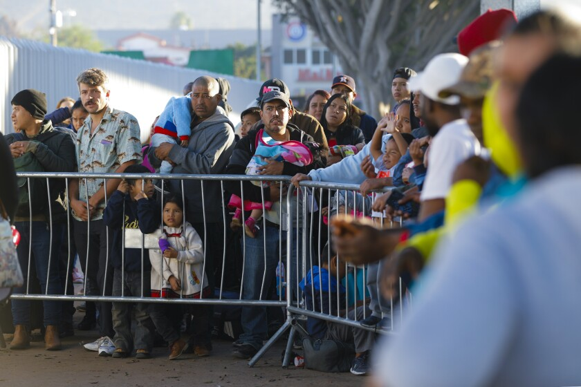 On Thursday October 24, 2019, at the El Chaparral port of entry in Mexico, families wait hoping their number is called.