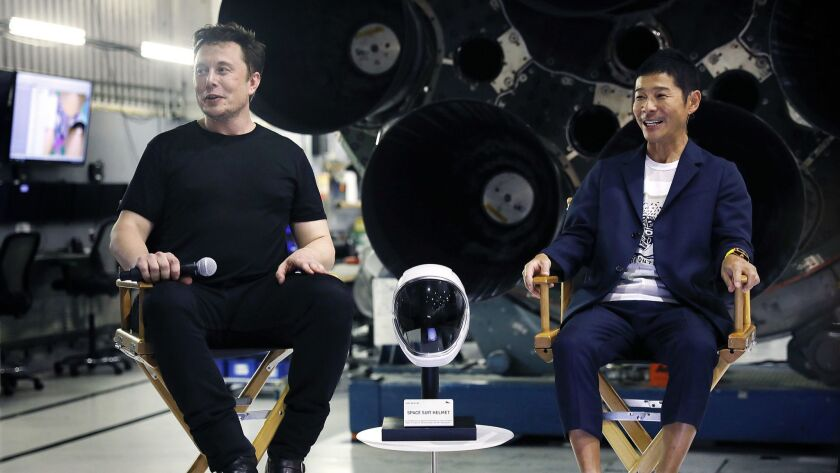 SpaceX CEO Elon Musk, left, announces the first private passenger who will fly around the moon aboard BFR in 2023: Japanese entrepreneur Yusaku Maezawa, right.