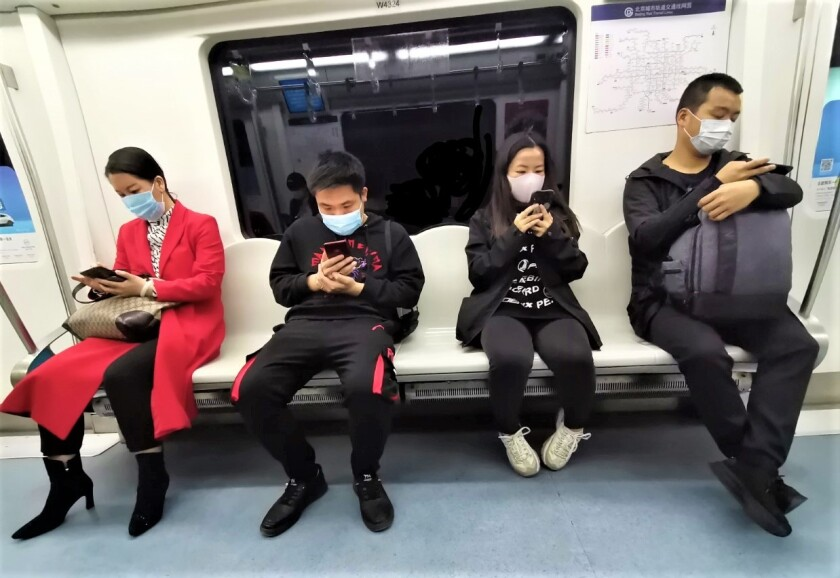 Post-coronavirus life is starting to return to semi-normal in Beijing, as this photo posted April 10 by former San Diegan Jim Healy shows. People are starting to ride the subway again but are keeping their distance and wearing face masks.