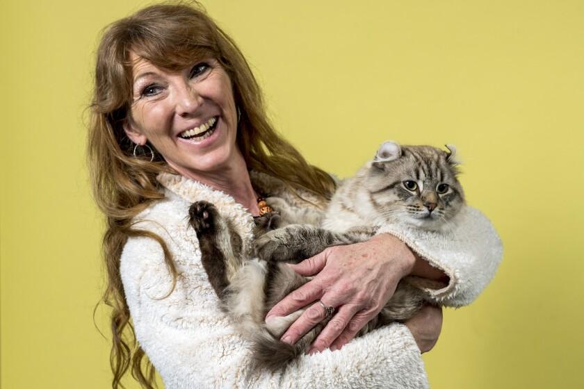 Bobbi Temple holds her Highlander cat named Troy Sloane.
