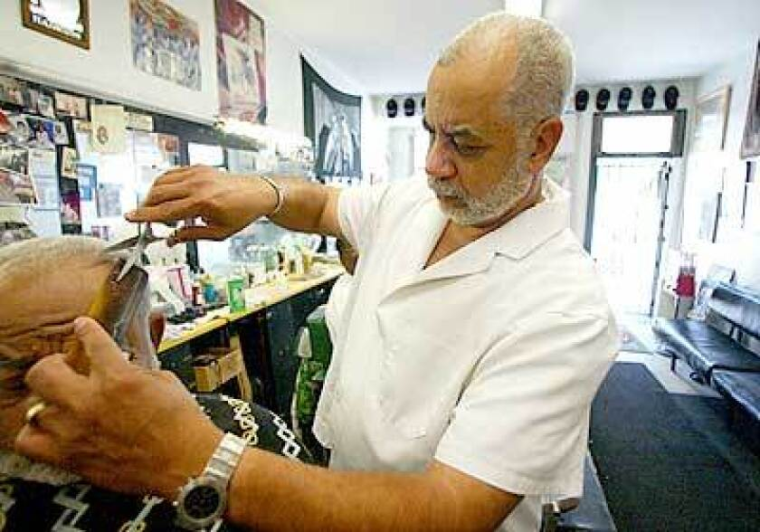 Lawrence Tolliver at his West Florence Avenue barbershop.