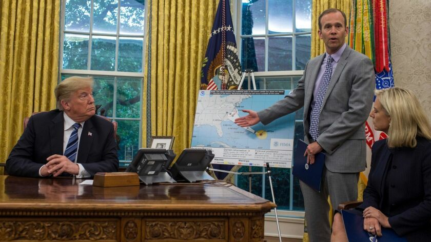 FEMA Administrator Brock Long speaks to members of the media in the Oval Office last week after briefing President Trump on Hurricane Florence.