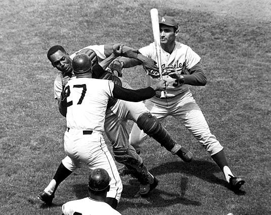 One of the ugliest Dodgers-Giants confrontations ever was when the Giants' Juan Marichal attacked catcher John Roseboro with a bat during a game at Candlestick Park. Marichal accused Roseboro of throwing a ball too close to his head. Sandy Koufax, the pitcher that day, came to his catcher's defense.