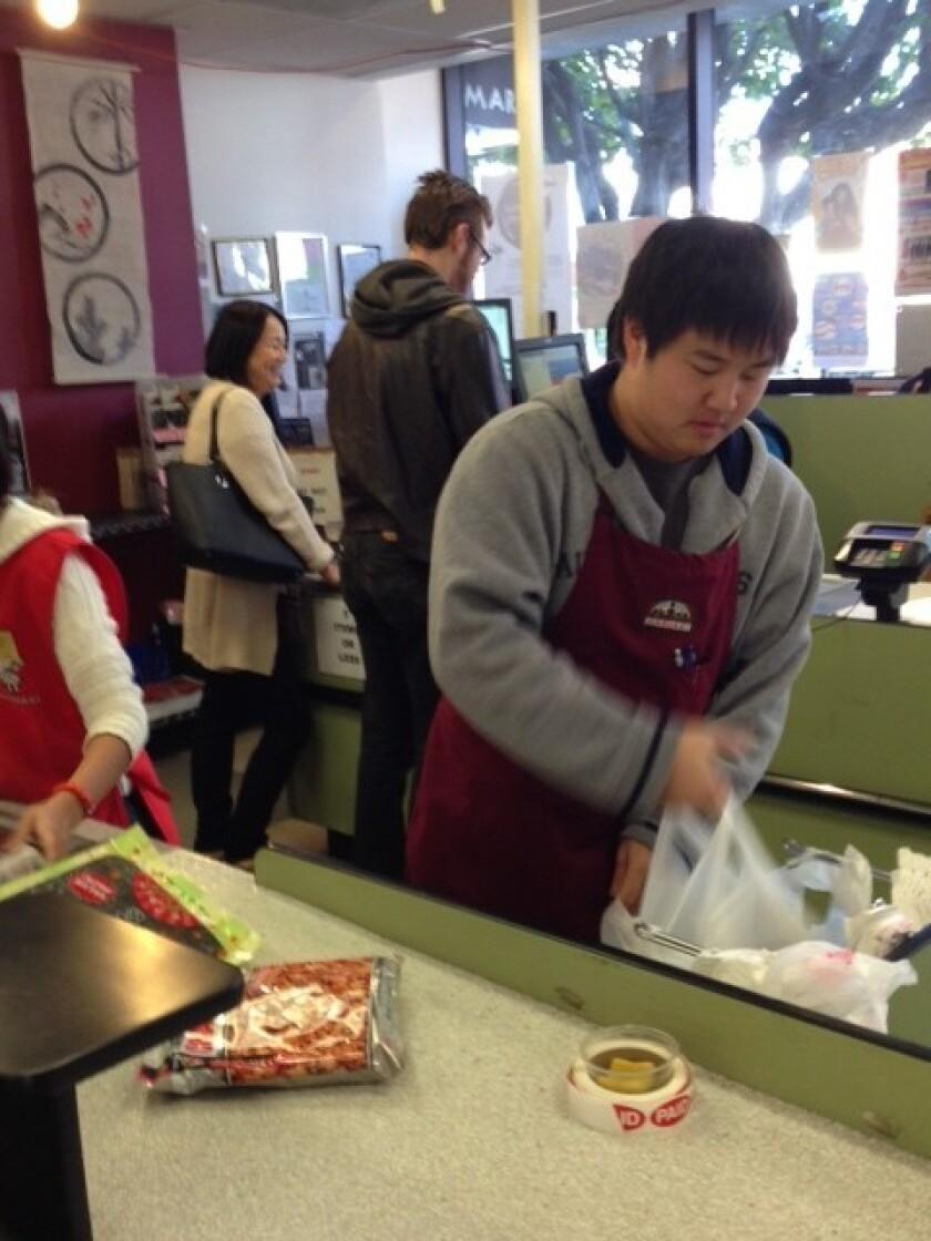 Nicholas Ogino bags groceries at Marukai Market in Little Tokyo