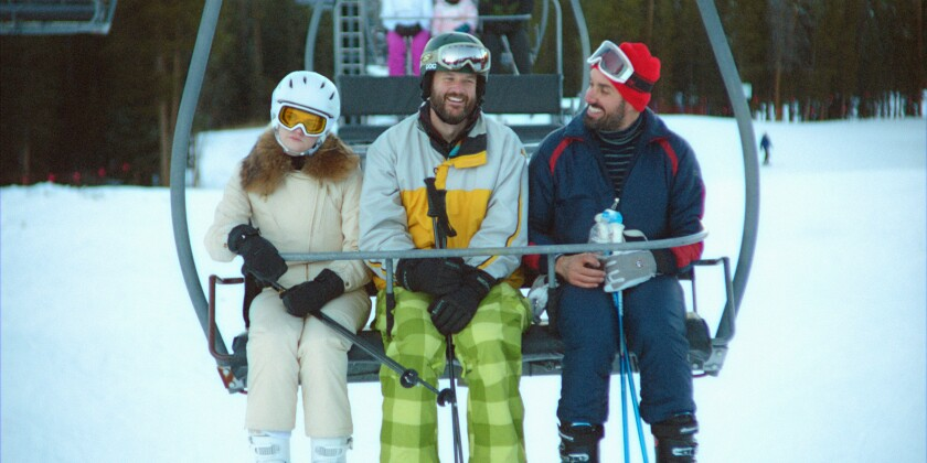 """Three people on a ski lift in the movie """"The Climb."""""""