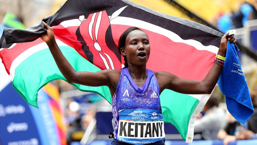 Mary Keitany, Stanley Biwott win NYC Marathon titles