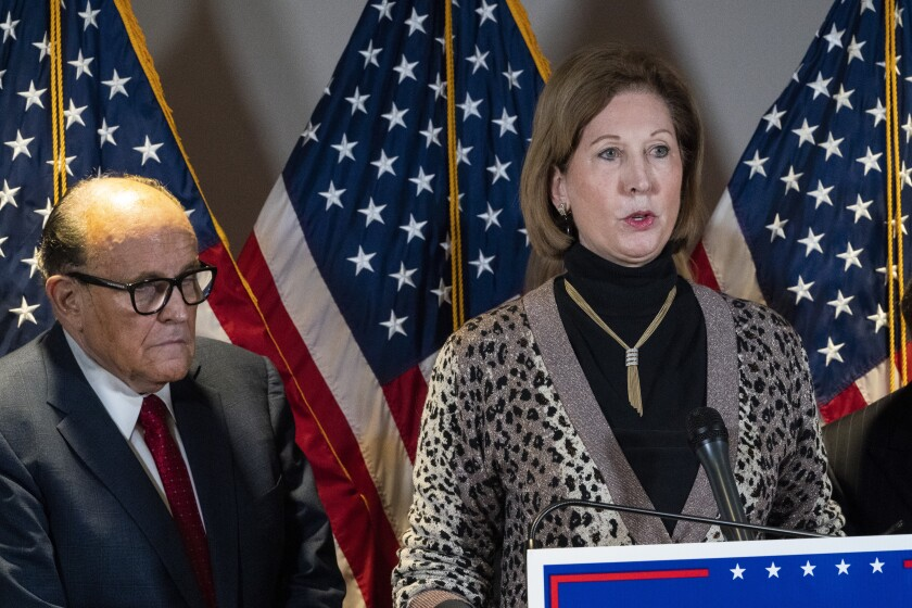 Sidney Powell, right, speaks next to former Mayor of New York Rudy Giuliani, as members of President Donald Trump's legal team, during a news conference at the Republican National Committee headquarters, Thursday Nov. 19, 2020, in Washington. (AP Photo/Jacquelyn Martin)