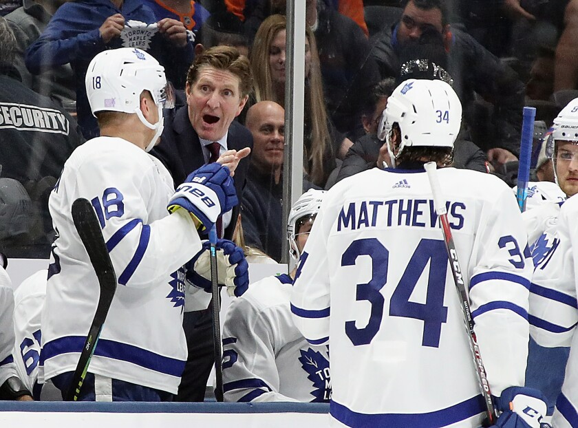 Maple Leafs coach Mike Babcock talks to Andreas Johnsson (18) and Auston Matthews (34) during a game against the Islanders on Nov. 13 at NYCB Live's Nassau Coliseum.