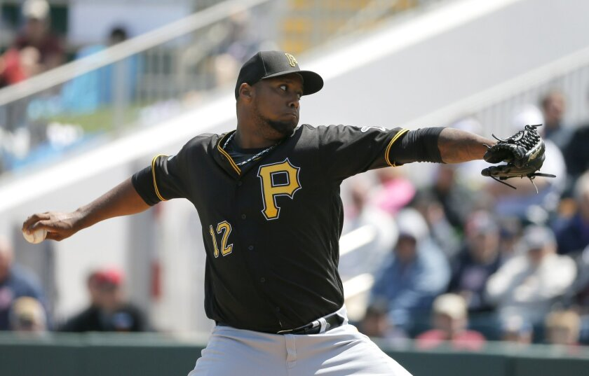 Pittsburgh Pirates starting pitcher Juan Nicasio works against the Minnesota Twins in the first inning of an interleague spring training baseball game, Monday, March 21, 2016, in Fort Myers, Fla. (AP Photo/Tony Gutierrez)