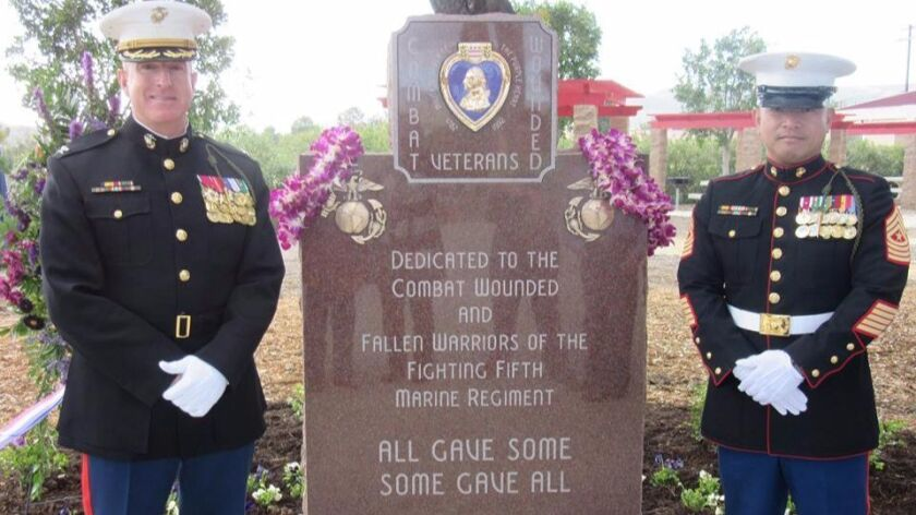 Col. Kenneth Kassner, commanding officer of the 5th Marine Regiment, left, and Sgt. Maj. Chuong Nguyen, the command's senior enlisted member, at the dedication of the Purple Heart memorial for the 5th Marine Regiment at Camp Pendleton.