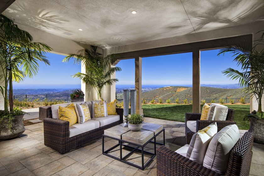 Views from a California room at a model home at The Estates stretch to the ocean. The homes are atop one of the highest peaks in San Diego's North County.