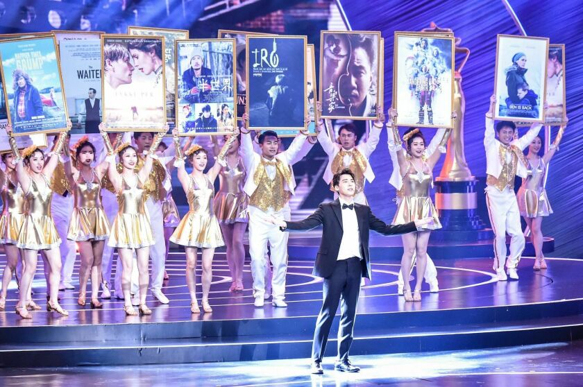 Chinese actor and singer Li Yifeng performs during the closing and award presentation ceremony of th