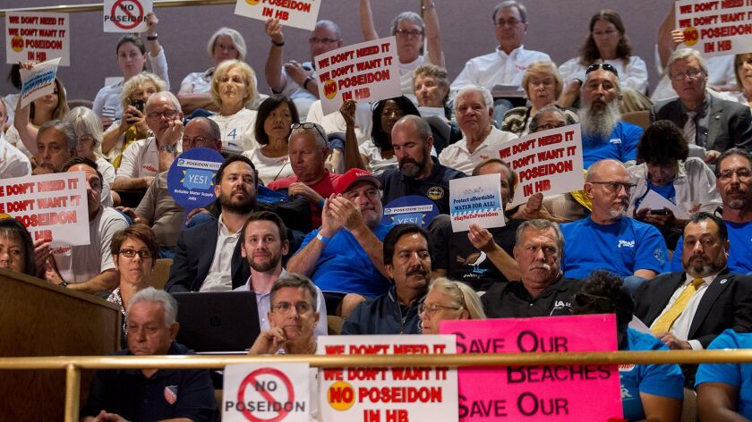 Detractors and supporters of the Poseidon desalination water facility attend a meeting in 2017.