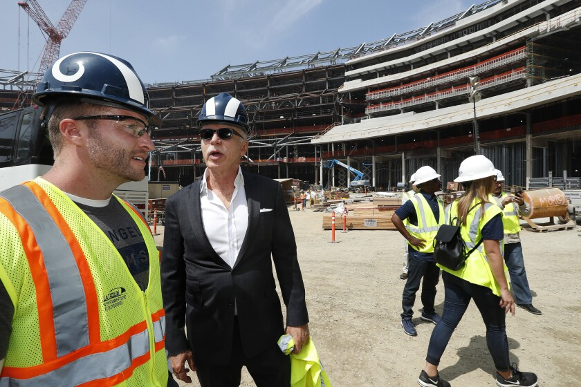 Rams head coach Sean Mcvay, left, talks with team owner Stan Kroenke during a tour of SoFi Stadium at Hollywood Park in Inglewood in June 2018.