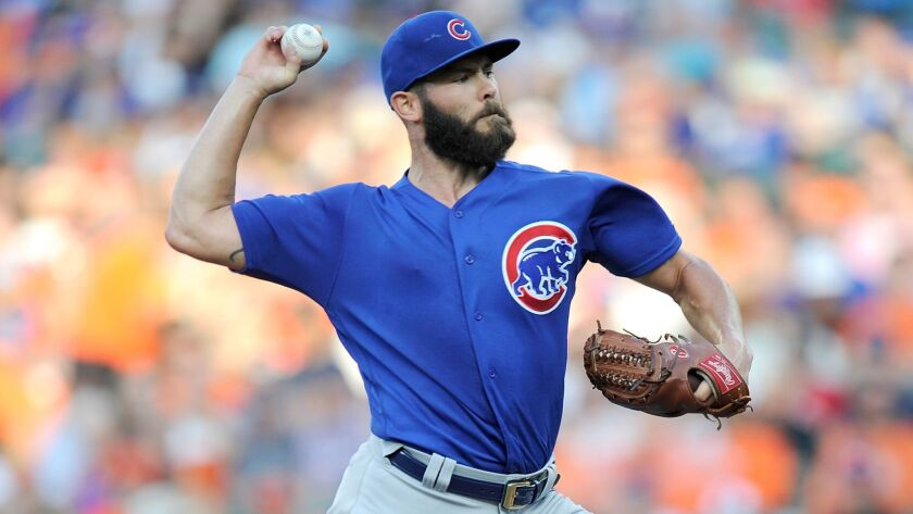 Jake Arrieta of the Chicago Cubs pitches in the first inning against the Baltimore Orioles at Oriole Park at Camden Yards on July 15, 2017.