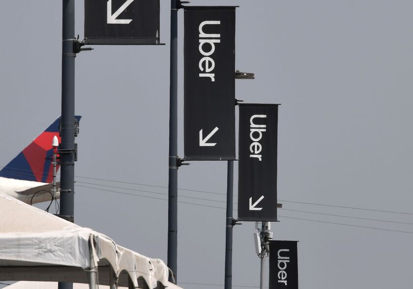 Uber signs are seen August 20, 2020 at Los Angeles International Airport in Los Angeles, California.