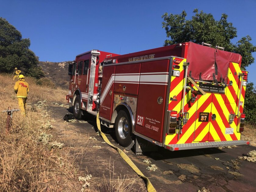 Firefighters worked overnight Wednesday into Thursday to dig containment lines around a 25-acre blaze in Dehesa. The fire was fully contained as of 2:30 p.m. Thursday.