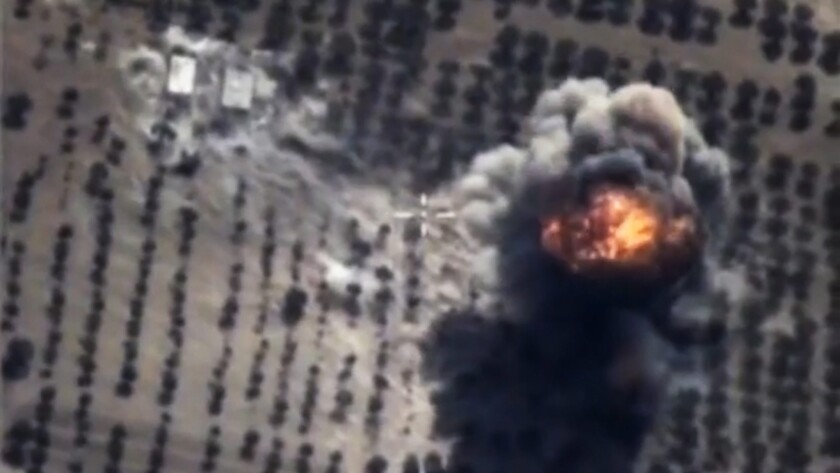 An image from video released by the Russian Defense Ministry shows a bomb explosion after an airstrike carried out by a Russian Su-24M bomber in Syria.