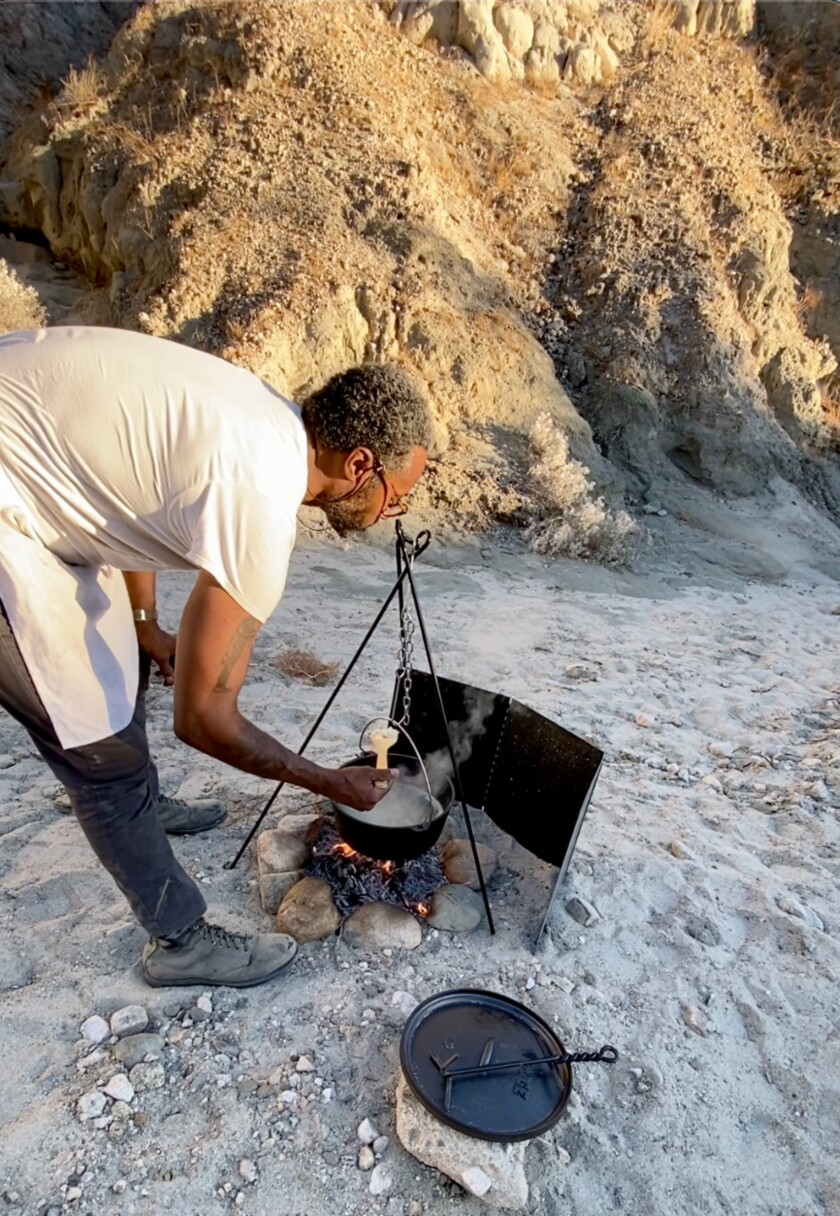 Barrett cooking rice in the canyons south of Joshua Tree.