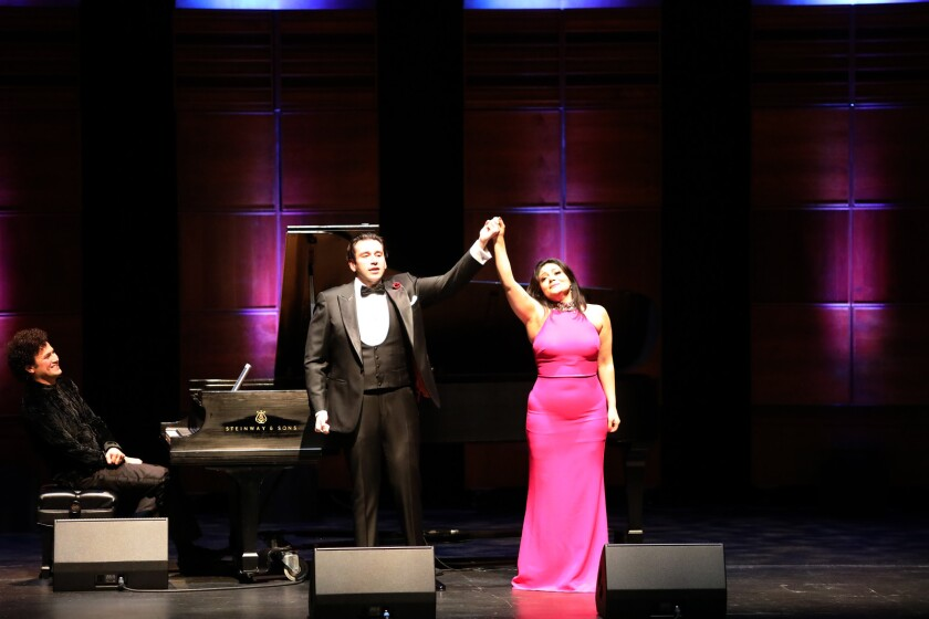 "Tenor Joshua Guerrero and soprano Ailyn Perez take a bow with pianist Abdiel Vazquez, at left, during San Diego Opera's ""One Amazing Night"" concert on Dec. 11 at the Balboa Theatre."