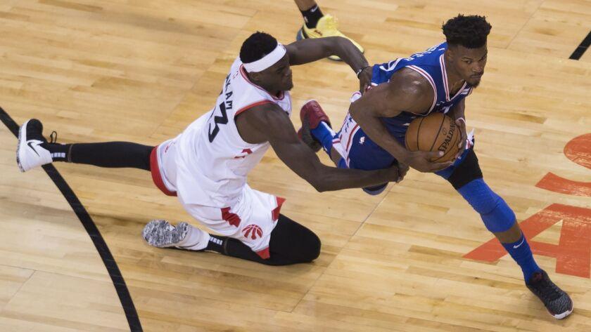 Toronto Raptors forward Pascal Siakam (43) fouls Philadelphia 76ers guard Jimmy Butler (23) during t
