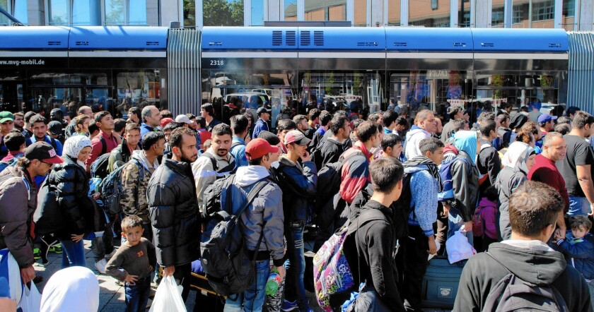 Refugees arrive at Munich train station