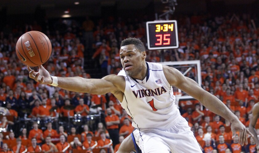 Virginia guard Justin Anderson goes after a rebound during the first half of the Cavaliers' 69-63 loss to the Duke Blue Devils on Saturday at John Paul Jones Arena in Charlottesville, Va.