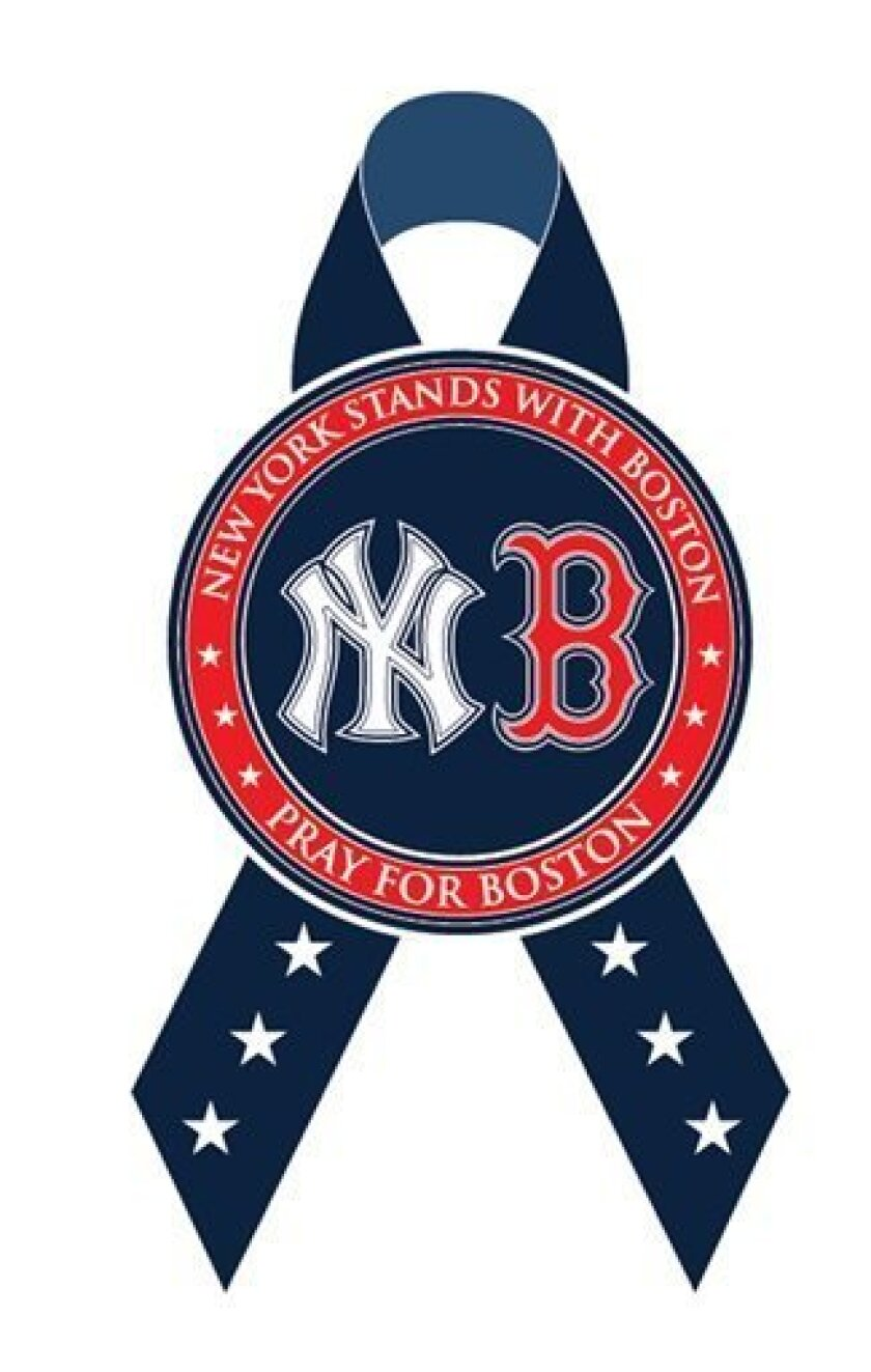 This image provided on Tuesday, April 16, 2013, by the New York Yankees shows a commemorative ribbon to convey New York's solidarity with Boston. The ribbon will be displayed on the Yankee Stadium scoreboard during a moment of silence honoring those who lost their lives or were injured in explosions Monday at the Boston Marathon, prior to their game on Tuesday, April 16. (AP Photo/New York Yankees)