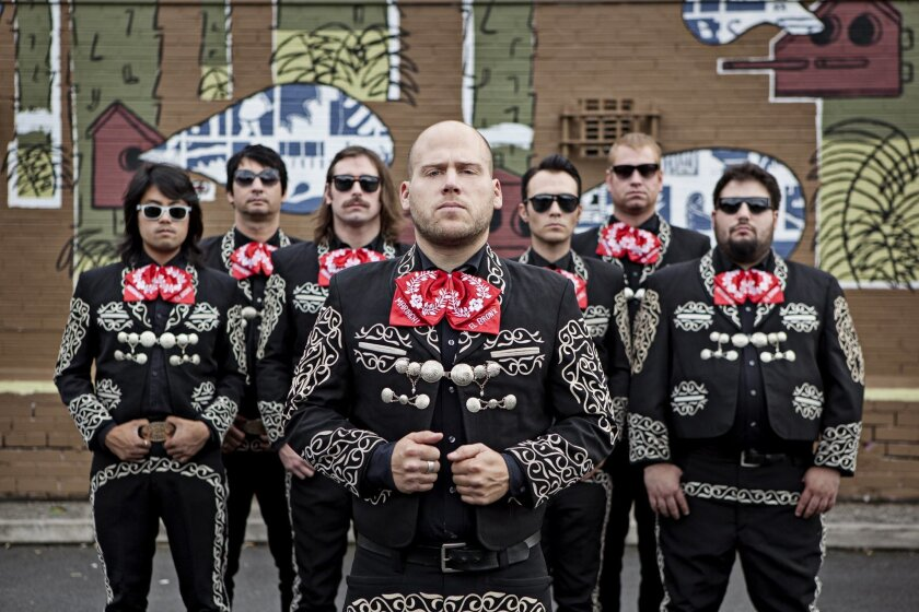 Borders-leaping band Mariachi El Bronx performs at SDSU's Viejas Arena Monday with Foo Fighters. The band's members are, from left: violinist Ray Suen; Jarana player Ken Horne (both from San Diego); trumpeter Brad Magers; lead singer Matt Caughthran; drummer Jorma Vik; guitarist Joby Ford; and Guit