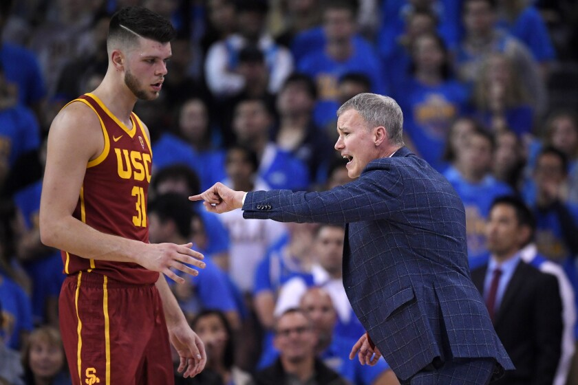 USC head coach Andy Enfield, right, yells at forward Nick Rakocevic during the first half against UCLA on Saturday at Pauley Pavilion.