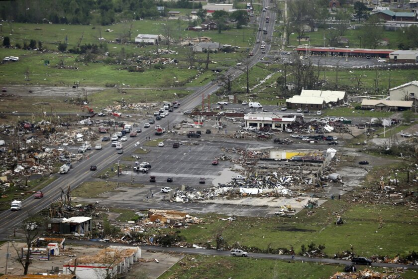 FILE - This Monday, April 28, 2014 aerial photo shows destroyed buildings and debris along U.S. Highway 64 in Vilonia, Ark. Vilonia was hit hard Sunday for the second time in three years. Four people were killed in a 2011 storm. Until this late April 2014 outbreak, the U.S. as a whole had by far th