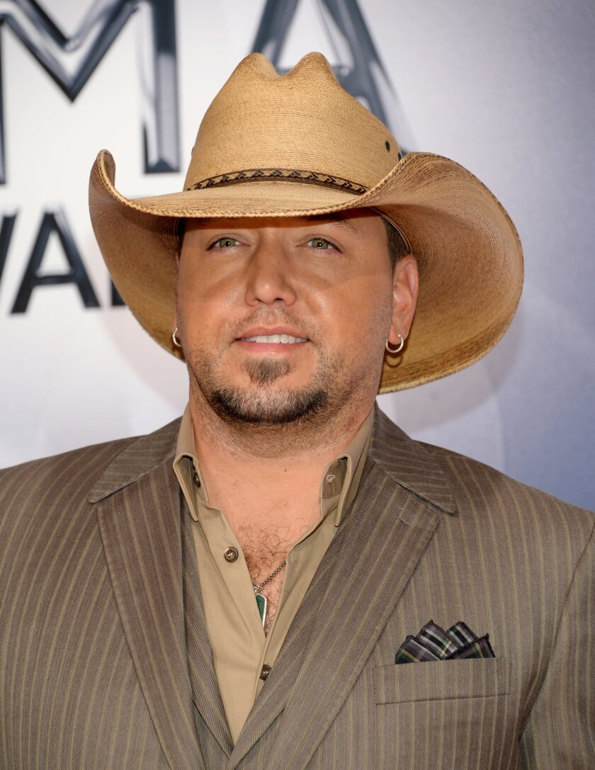 Jason Aldean arrives at the 49th annual CMA Awards at the Bridgestone Arena on Wednesday, Nov. 4, 2015, in Nashville, Tenn. (Photo by Evan Agostini/Invision/AP)