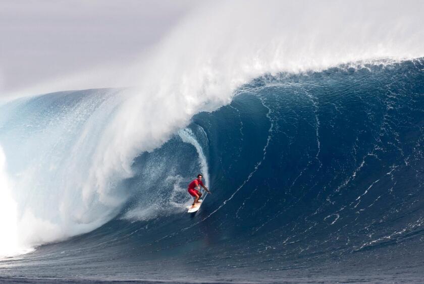 La Jolla surfer Jon Roseman gets barreled, showcasing his surfing skills.