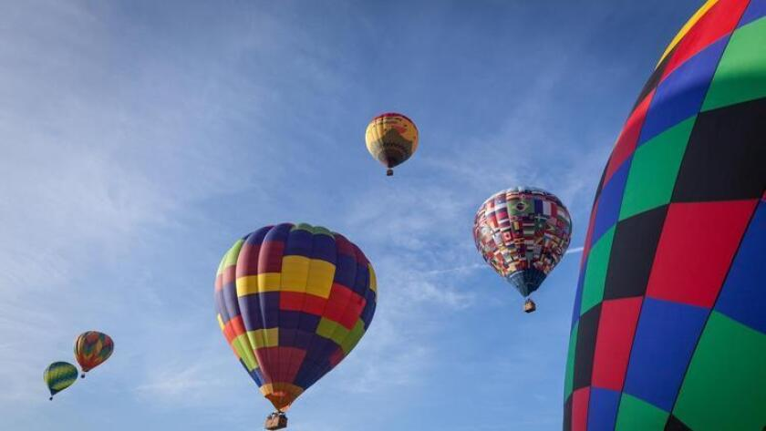 Hop in a hot air balloon to spend your extra hours way up high. (Courtesy photo)