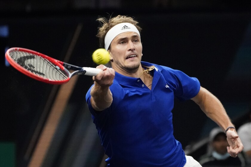 Team Europe's Alexander Zverev, of Germany, returns the ball to Team World's John Isner, of the USA, during Laver Cup tennis, Saturday, Sept. 25, 2021, in Boston. (AP Photo/Elise Amendola)