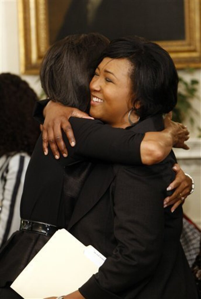 First lady Michelle Obama, left, hugs former NASA Astronaut Mae C. Jemison, right, as she welcomes guests to the Diplomatic Room of the White House in Washington, Thursday, March 19, 2009, as she hosted a series of events in celebration of Women's History Month. Twenty-one women at the top of their fields will join the first lady in visiting local schools and speaking with students about their career goals. (AP Photo/Pablo Martinez Monsivais)