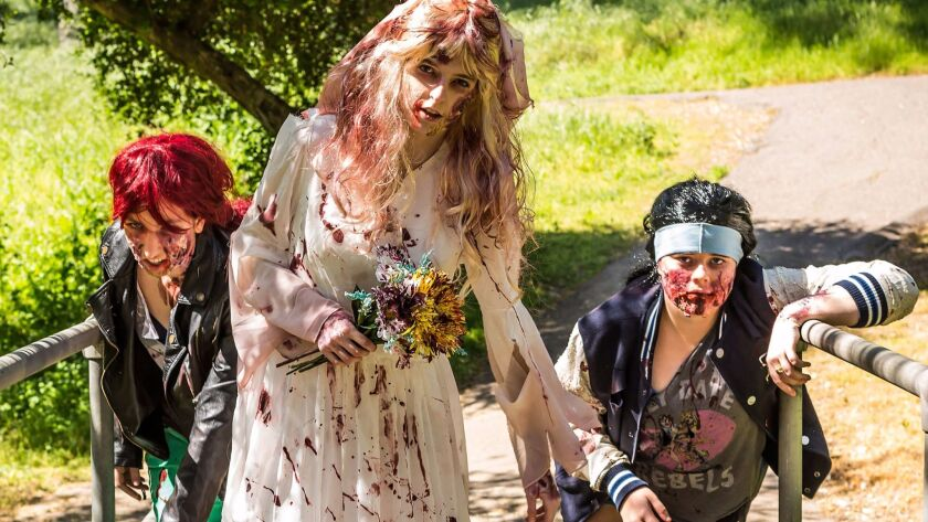 """Turning Tyde Theatre's """"Into the Walker Woods"""" is a mashup of a zombie TV series and the Sondheim mu"""