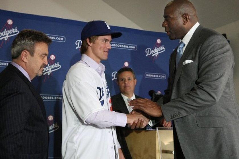 Dodgers co-owner Magic Johnson, right, with new team acquisition Zack Greinke.