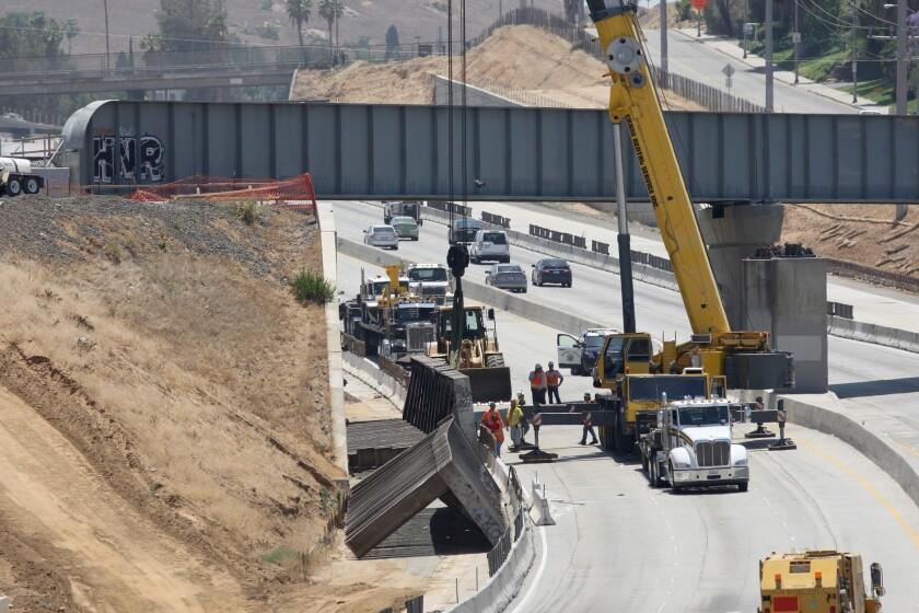One killed when Riverside bridge collapses onto 91 Freeway