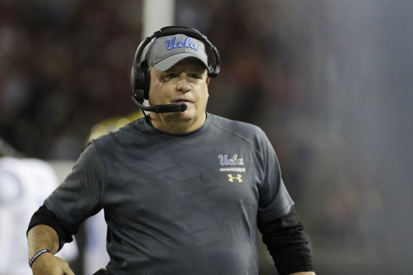 UCLA coach Chip Kelly looks on from the sideline during a game.