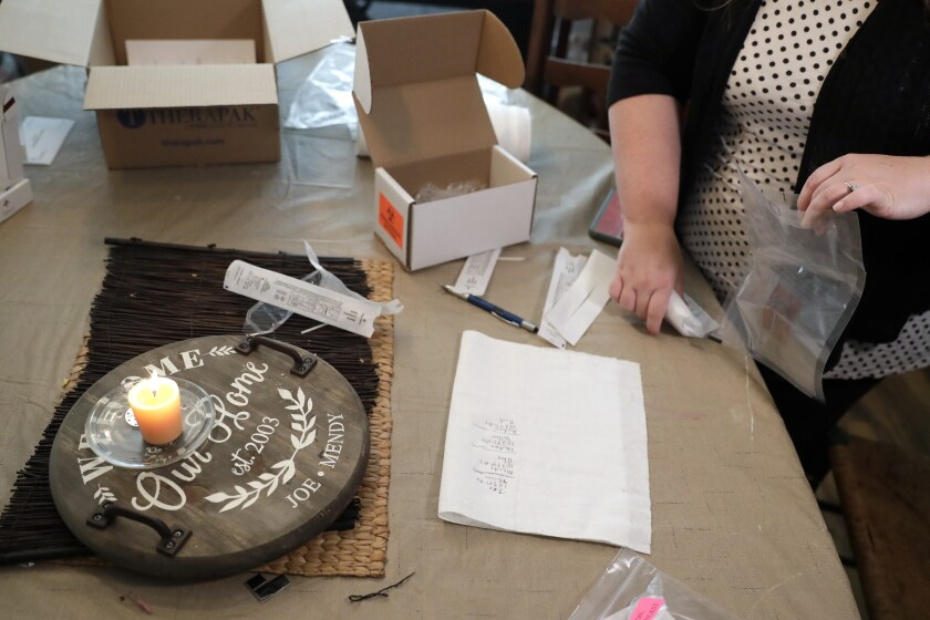 Mendy McNulty gathers test swabs together for shipment