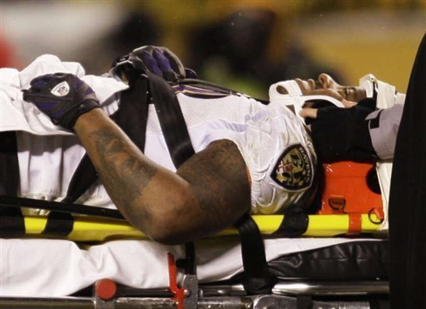 Baltimore Ravens running back Willis McGahee is carried off the field on a stretcher after being hit by Pittsburgh Steelers' Ryan Clark after a pass catch in the  fourth quarter of the NFL AFC championship football game in Pittsburgh, Sunday, Jan. 18, 2009. (AP Photo/Rob Carr)