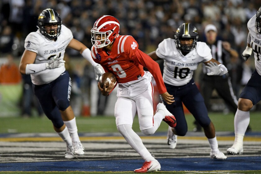 Mater Dei quarterback Bryce Young breaks into the St. John Bosco secondary in the first half at Santa Ana Stadium on Oct. 13, 2018.