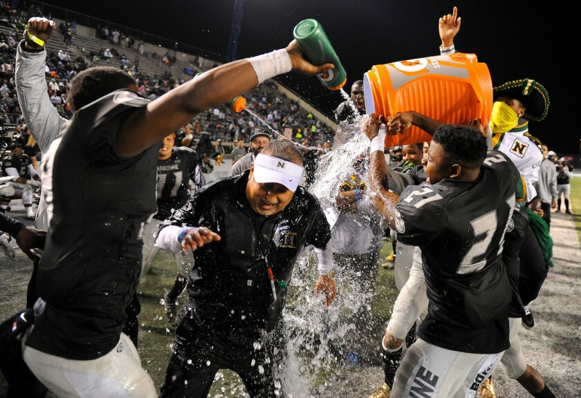 Narbonne coach Manuel Douglas gets doused with water by his players after beating Crenshaw.