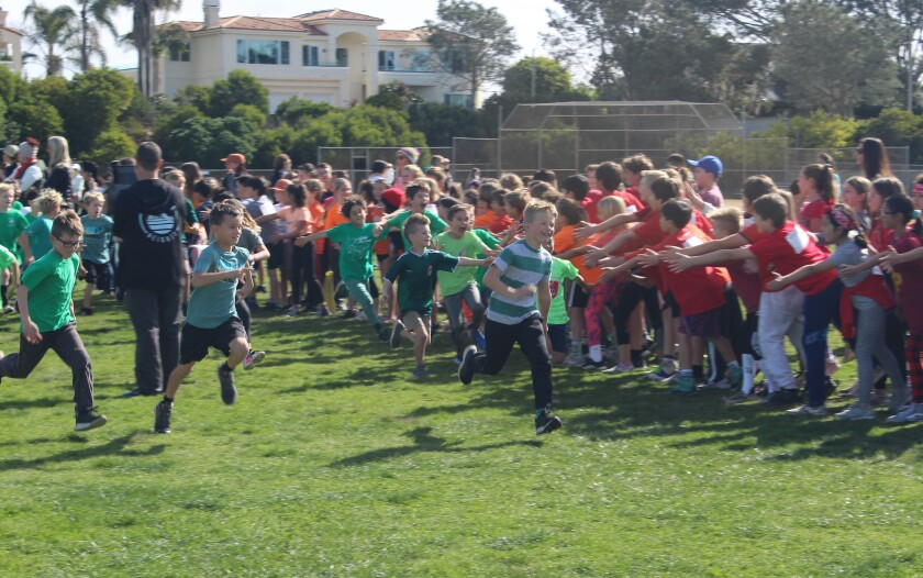 Students cheer on the runners in the Del Mar Heights jogathon.