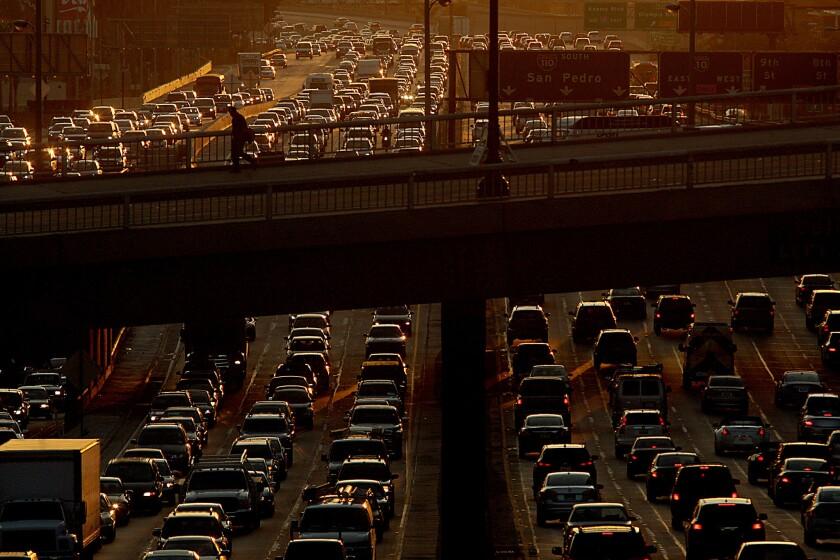 Traffic jams the 110 Freeway as drivers make their weekend getaways five days before Christmas in 2013.