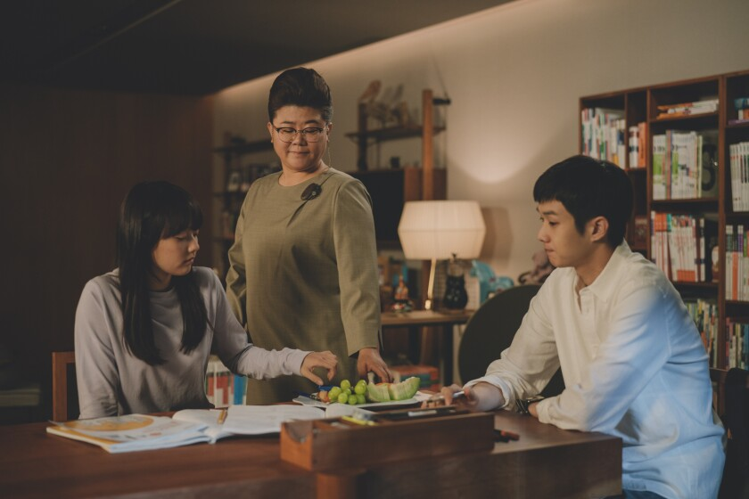 "Ji So Jung, Jeong Eun Lee and Woo Sik Choi in a scene from ""Parasite."""