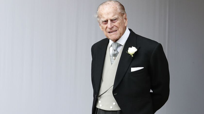 FILE - In this Friday, Oct. 12, 2018 file photo, Britain's Prince Philip waits for the bridal proces