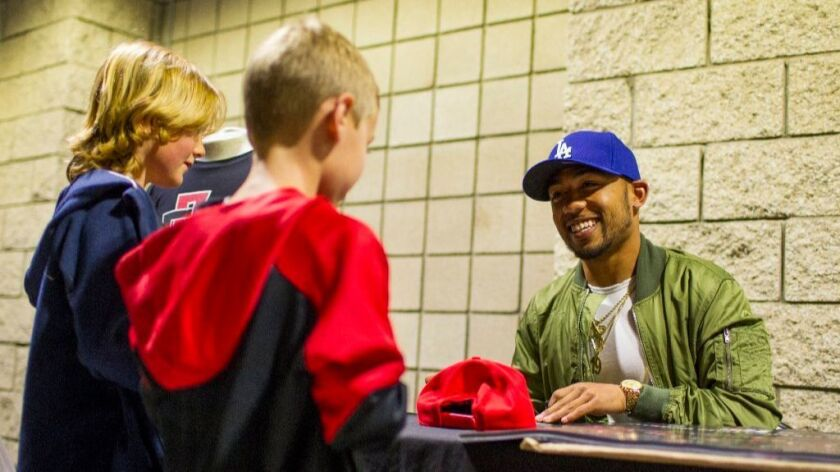 SDSU vs Fresno State basketball at SDSU's Viejas Arena on February 22, 2017. Prior to the basketball game, Aztec football running back Donnel Pumphrey Jr. signed autographs and took pictures with fans.