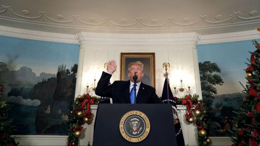 President Donald Trump speaks in the Diplomatic Reception Room of the White House, Wednesday, Dec. 6